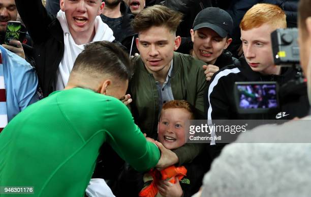 A young fan can't hide his delight after Ederson of Manchester City gives him his shirt after the Premier League match between Tottenham Hotspur and...