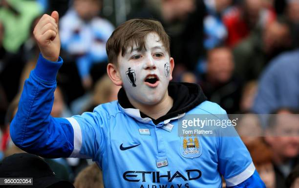 A young fan celebrates during the Premier League match between Manchester City and Swansea City at Etihad Stadium on April 22 2018 in Manchester...