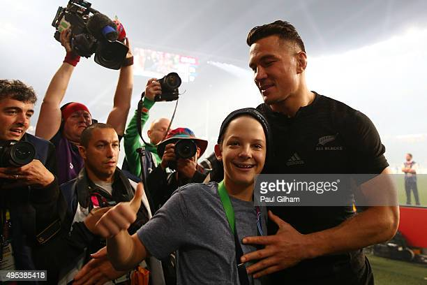 Young fan Charlie Lines reacts to being presented with the winning medal of Sonny Bill Williams of New Zealand after the 2015 Rugby World Cup Final...