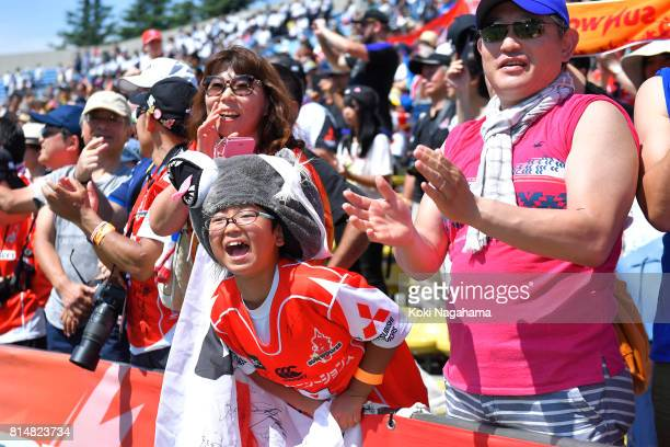 A young fan cheers after winning the Super Rugby match between the Sunwolves and the Blues at Prince Chichibu Stadium on July 15 2017 in Tokyo Japan