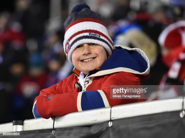 A young fan cheers as the Ottawa Senators take on the Montreal Canadiens during the 2017 Scotiabank NHL100 Classic at Lansdowne Park on December 16...