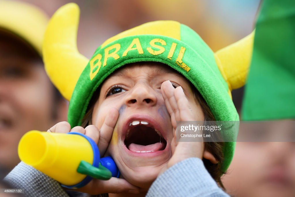 A young fan cheers before the 2014 FIFA World Cup Brazil Group A match between Brazil and Croatia at Arena de Sao Paulo on June 12, 2014 in Sao Paulo, Brazil.
