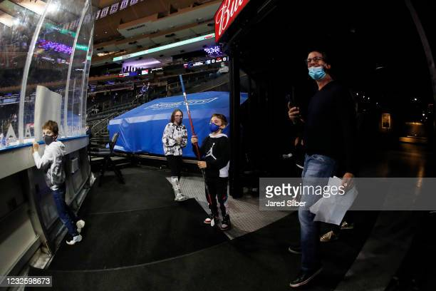 Young fan cheers during warmups after getting a stick from Artemi Panarin of the New York Rangers prior to the game against the New York Islanders at...