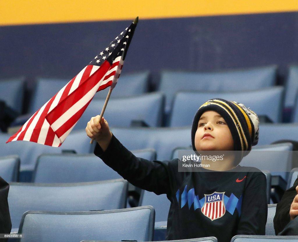 A young fan cheers for the the United States in the first period against Slovakia during the IIHF World Junior Championship at KeyBank Center on December 28, 2017 in Buffalo, New York.