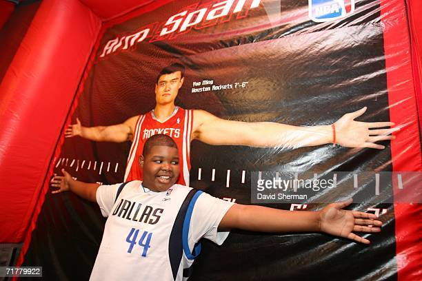 A young fan compares his arm span to Yau Ming's at the NBA Experience booth at the Minnesota State Fair on September 3 2006 in St Paul Minnesota NOTE...