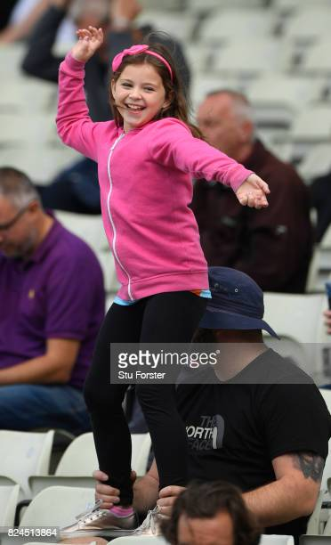 Young fan dances to the music during the Natwest T20 Blast match between Birmingham Bears and Lancashire Lightning at Edgbaston on July 30, 2017 in...
