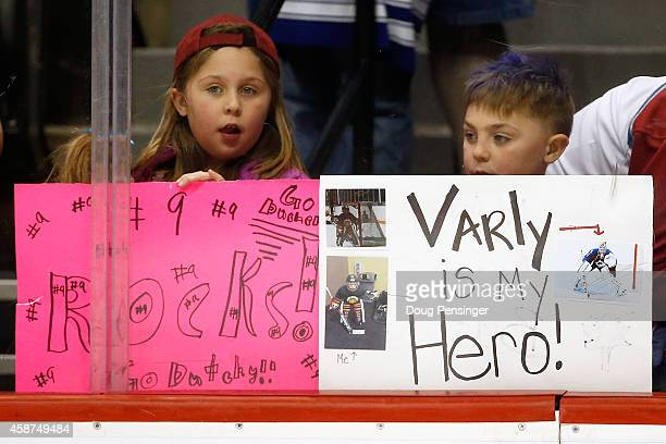 A young fan displays a sign in support of goalie Semyon Varlamov of the Colorado Avalanche while another young fan supports Matt Duchene of the...