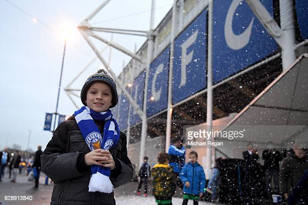 A young fan enjoy the pre match atmosphere outside the stadium prior to the Premier League match between Leicester City and Manchester City at the...