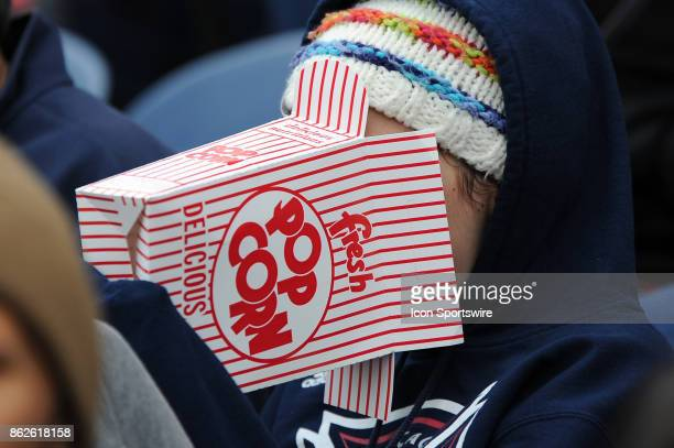 A young fan enjoys popcorn during a game between the Philadelphia Union and the Chicago Fire on October 15 at Toyota Park in Bridgeview IL