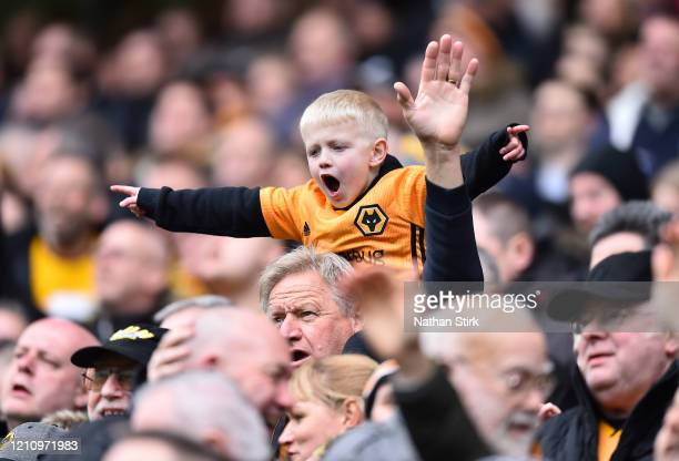 Young fan enjoys the atmosphere inside the stadium during the Premier League match between Wolverhampton Wanderers and Brighton & Hove Albion at...