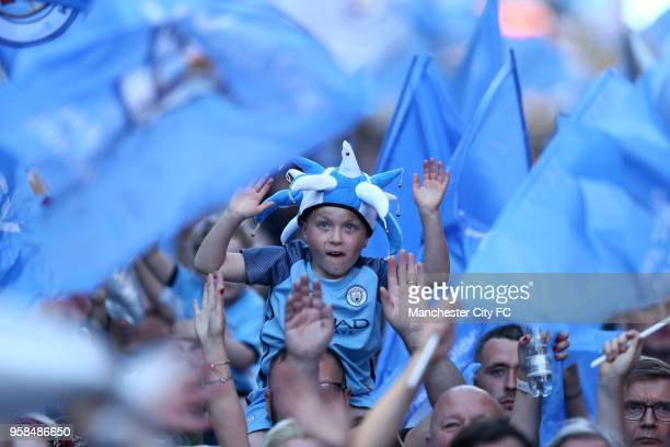 A young fan enjoys the atmosphere prior to the Manchester City Trophy Parade on May 14 2018 in Manchester England