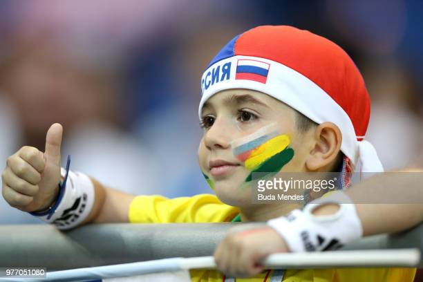 A young fan enjoys the pre match atmosphere prior to the 2018 FIFA World Cup Russia group E match between Brazil and Switzerland at Rostov Arena on...