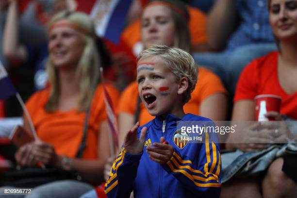 A young fan enjoys the pre match atmosphere prior to the Final of the UEFA Women's Euro 2017 between Netherlands v Denmark at FC Twente Stadium on...