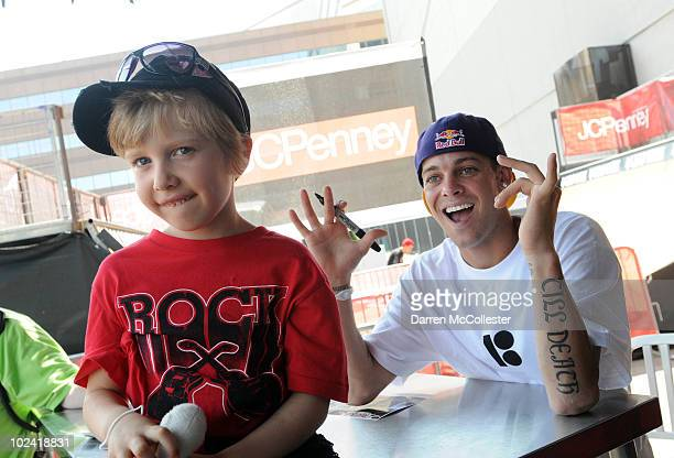 A young fan gets autographs from skateboarder Ryan Sheckler at the JCPenney Tent on June 25 2010 in Boston Massachusetts The Dew Tour's Skate Open...