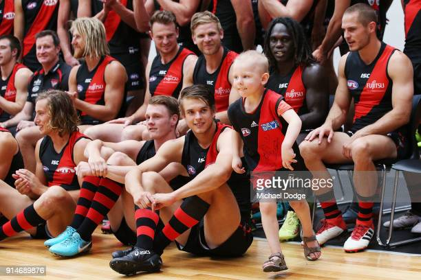 A young fan gets his chance to be photographed with Anthony McDonaldTipungwuti of the Bombers during an Essendon Bombers team photo session at The...