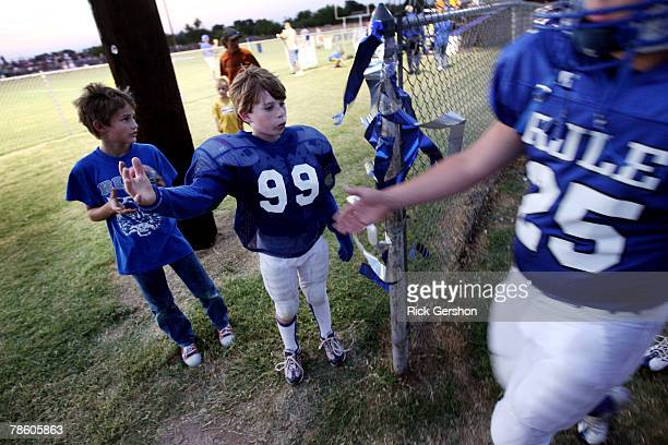 A young fan greets the Rule Bobcats as they prepare to take on the Throckmorton Greyhounds in a six man football matchup on October 12 2007 in Rule...