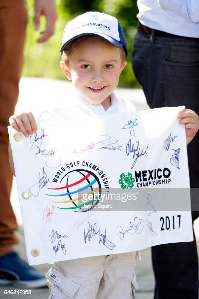 A young fan holds a flag with signatures during practice for the World Golf Championships Mexico Championship at Club De Golf Chapultepec on March 1...