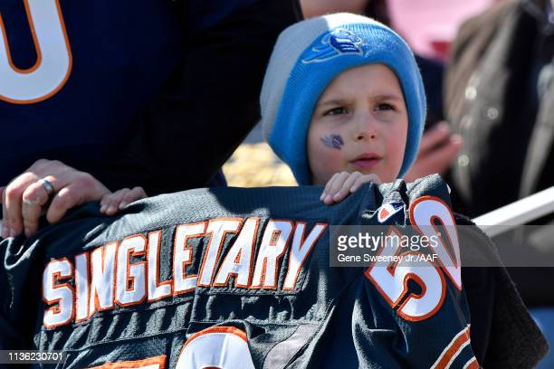 A young fan holds a Mike Singletary Chicago Bears jersey in support of the Memphis Express head coach before they take on the Salt Lake Stallions at...