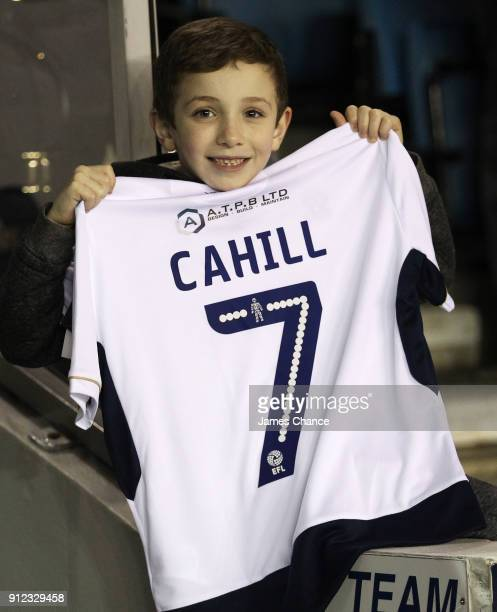 A young fan holds a shirt welcoming new Millwall signing Tim Cahill prior to the Sky Bet Championship match between Millwall and Derby County at The...