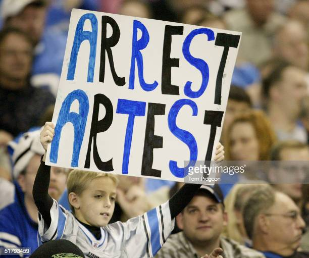 A young fan holds a sign reading 'Arrest Artest' during the NFL game featuring the Indianapolis Colts against the Detroit Lions at Ford Field on...