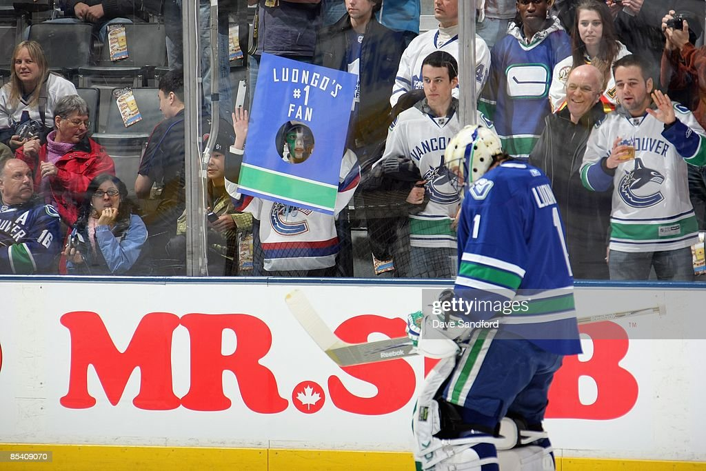 A Young Fan Holds Up A Sign As Roberto Luongo Of The Vancouver