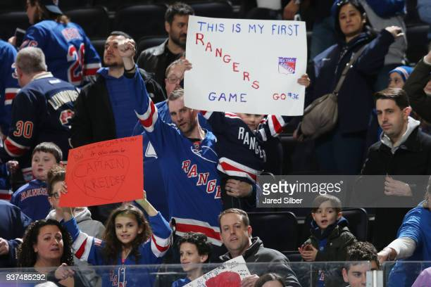 A young fan holds up a sign as the New York Rangers warm up prior to the game against the Buffalo Sabres at Madison Square Garden on March 24 2018 in...