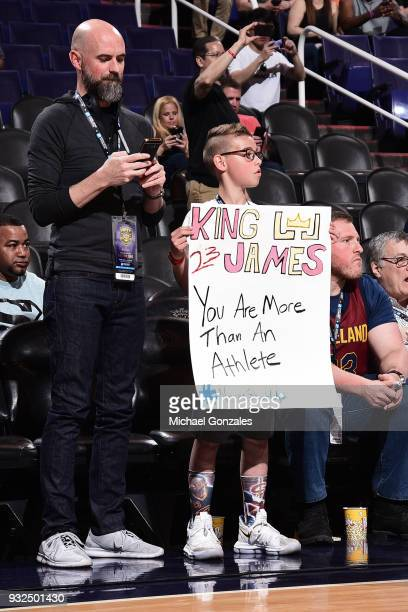 A young fan holds up a sign in support in LeBron James before the Cleveland Cavaliers game against the Phoenix Suns on March 13 2018 at Talking Stick...
