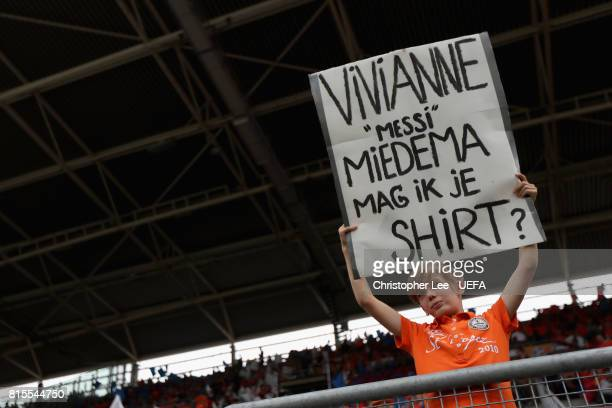 A young fan holds up a sign prior to the Group A match between Netherlands and Norway during the UEFA Women's Euro 2017 at Stadion Galgenwaard on...