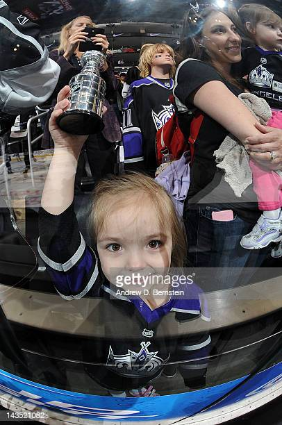 A young fan holds up a Stanley Cup prior to the game between the Los Angeles Kings and the Vancouver Canucks in Game Four of the Western Conference...