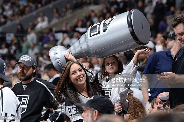 A young fan holds up an inflatable Stanley Cup during Game Five of the 2014  NHL c0076849502