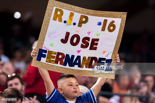 A young fan honors Jose Fernandez of the Miami Marlins during the MLB game between the San Diego Padres and Arizona Diamondbacks at Chase Field on...