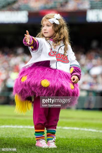 A young fan in an Indians mascot Slider costume on Kids Fun Day prior to the Major League Baseball game between the New York Yankees and Cleveland...