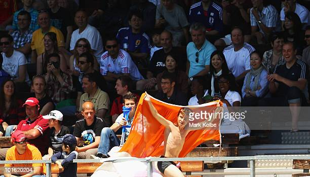 A young fan in his underpants runs with an Ivory Coast flagduring the Japan v Ivory Coast International Friendly match at Stade de Toubillon on June...