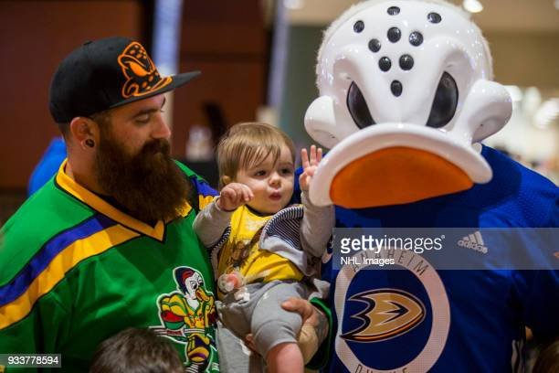 A young fan interacts with Anaheim Ducks mascot Wild Wing before the game against the New Jersey Devils at Honda Center on March 18 2018 in Anaheim...
