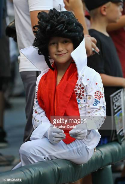 A young fan is dressed like Elvis Presley on 'Elvis Night' at Guaranteed Rate Field as the Chicago White Sox take on the Kansas City Royals on August...