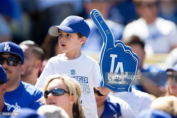A young fan is seen holding a foam finger during the game between the Los Angeles Dodgers and the Colorado Rockies at Dodger Stadium on Sunday April...