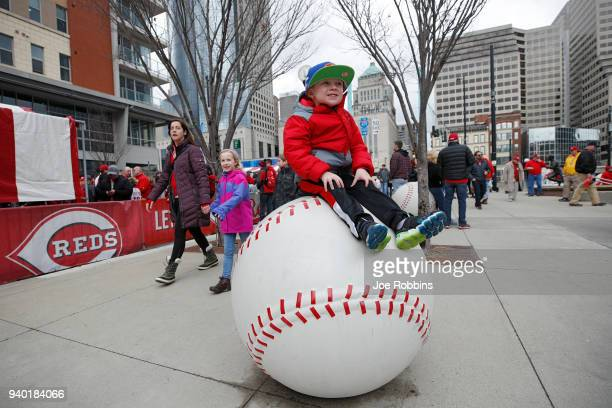 A young fan is seen outside the ball park prior to the Opening Day game between the Cincinnati Reds and Washington Nationals at Great American Ball...