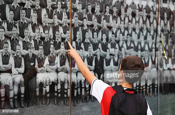 A young fan looks at the Arsenal mural prior to the Premier League match between Arsenal and Chelsea at the Emirates Stadium on September 24 2016 in...