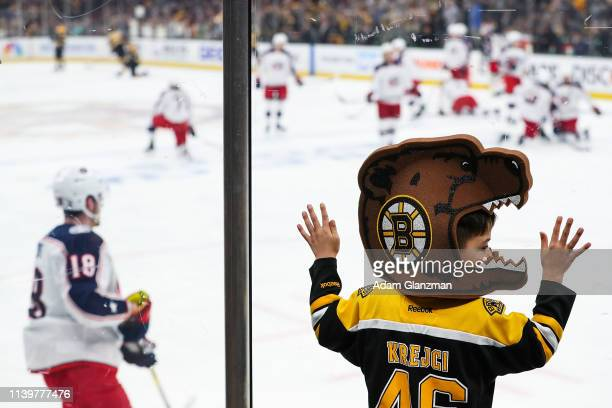 A young fan looks on before a game between the Boston Bruins and the Columbus Blue Jackets in Game Two of the Eastern Conference Second Round during...