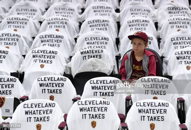 A young fan looks on before Game Six of the 2018 NBA Eastern Conference Finals between the Cleveland Cavaliers and the Boston Celtics at Quicken...
