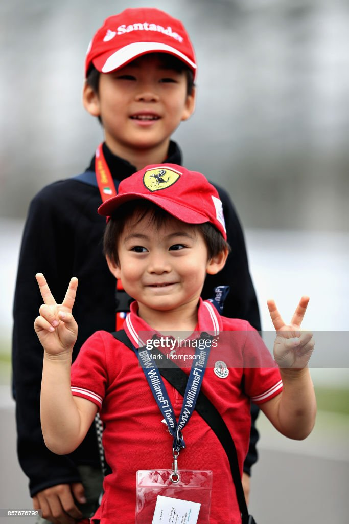 A young fan looks on during previews ahead of the Formula One Grand Prix of Japan at Suzuka Circuit on October 5, 2017 in Suzuka.