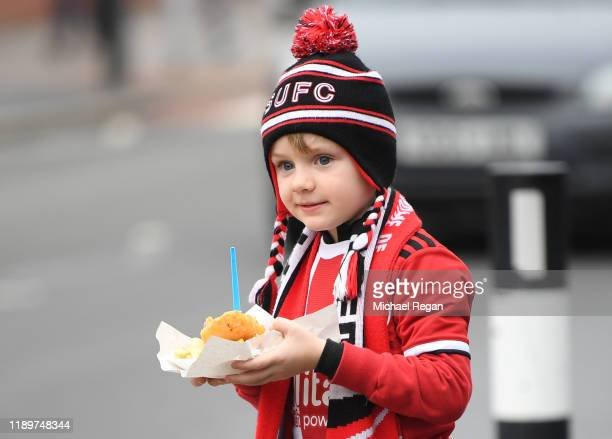 A young fan looks on outside the stadium prior to the Premier League match between Sheffield United and Manchester United at Bramall Lane on November...