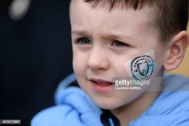A young fan looks on prior to the Premier League match between Manchester City and Manchester United at Etihad Stadium on April 7 2018 in Manchester...