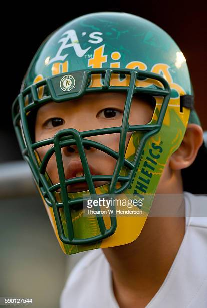 A young fan looks on while seeking autographs prior to the start of the game between the Seattle Mariners and Oakland Athletics at the Oakland...