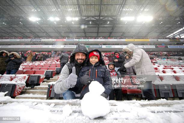Young fan makes a snowman prior to the Bundesliga match between 1 FC Koeln and SportClub Freiburg at RheinEnergieStadion on December 10 2017 in...