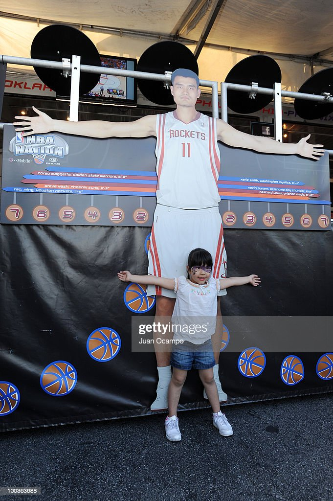 A young fan measures her arm span during the NBA Nation Tour on May 23, 2010 at Universal City Walk in Universal City, California.