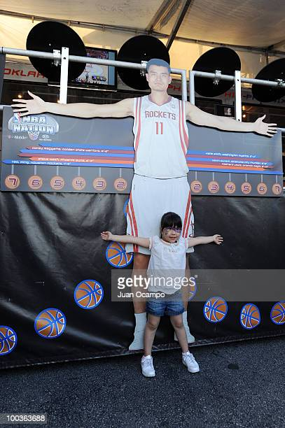 A young fan measures her arm span during the NBA Nation Tour on May 23 2010 at Universal City Walk in Universal City California NOTE TO USER User...