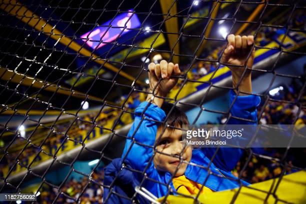 A young fan of Boca Juniors smiles prior to the Semifinal second leg match between Boca Juniors and River Plate as part of Copa CONMEBOL Libertadores...