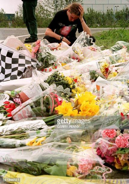 A young fan of Brazilian F1 driver Ayrton Senna reflects on the glory days of the threetime world champion after laying flowers at the gates of the...