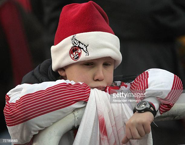 A young fan of Cologne looks dejected after his team lost 20 after the Second Bundesliga match between Kickers Offenbach and 1FC Cologne at the...
